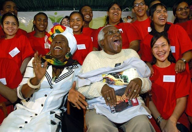 Desmond Tutu shares a laugh with Rita Marley, wife of Bob Marley, during a meeting with 20 young people.